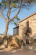 Building exterior with steps and balcony of Perleas Mansion guesthouse, Kampos, Chios, Greece