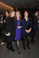 Left to right, PRINCESS BEATRICE OF YORK, SARAH, DUCHESS OF YORK and PRINCESS EUGENIE OF YORK at the launch of Samsung's NX Smart Camera at charity auction with David Bailey in aid of Marie Curie Cancer Care at the Bulgari Hotel, 171 Knightsbridge, London on 14th May 2013.
