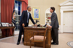 President Barack Obama talks with David Simas, Director of the Office of Political Strategy & Outreach, in the Oval Office, Oct. 14, 2014. (Official White House Photo by Pete Souza)<br /> <br /> This official White House photograph is being made available only for publication by news organizations and/or for personal use printing by the subject(s) of the photograph. The photograph may not be manipulated in any way and may not be used in commercial or political materials, advertisements, emails, products, promotions that in any way suggests approval or endorsement of the President, the First Family, or the White House.