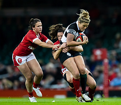 Dyddgu Hywel of Barbarians is tackled by Robyn Wilkins of Wales<br /> <br /> Photographer Simon King/Replay Images<br /> <br /> Friendly - Wales v Barbarians - Saturday 30th November 2019 - Principality Stadium - Cardiff<br /> <br /> World Copyright © Replay Images . All rights reserved. info@replayimages.co.uk - http://replayimages.co.uk