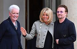 U2 lead singer and co-founder of the organisation ONE Bono stands alongside French First Lady Brigitte Macron and Gayle Smith, President and CEO of the ONE Campaign, at the Elysee Palace in Paris, France, on July 24, 2017. Bono will be meeting the French president in a bid to champion his organisation One which battles against extreme poverty and illness, particularly in Africa. Photo by Christian Liewig/ABACAPRESS.COM