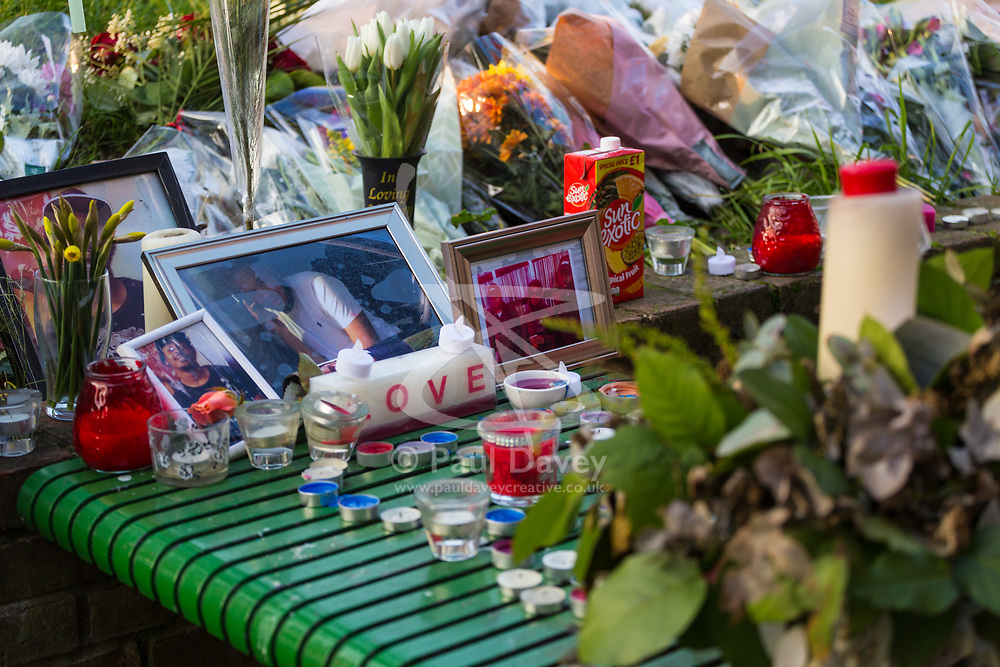 A shrine to Nuno, stabbed just days ago just yards from last night's murder of a teenager. Police man a cordon surrounding the scene on Bartholomew Road where a man was stabbed to death. Kentish Town, London, February 21 2018.
