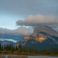 A sunset lights Mount Rundle, above Vermillion Lakes in Banff National Park, Alberta, Canada.