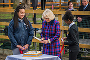 Cutting the birthday cake - The Duchess of Cornwall, President, Ebony Horse Club, visits the charity's Brixton riding centre. The centre is celebrating its 21st birthday and its 6th year on this site. London 16 Feb 2017 .
