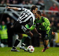 Photo. Andrew Unwin, Digitalsport<br /> Newcastle United v Sporting Lisbon, Uefa Cup Quarter Final First Leg, St James' Park, Newcastle upon Tyne 07/04/2005.<br /> Sporting's Liedson (R) is sent sprawling by a tackle from Newcastle's Steven Taylor