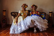"""Muxes during the celebration of the vela Muxe. The velas are celebrations that take place in the region of the Itsmo of Tehuantepec, in the state of Oaxaca, where they eat, drink and dance.<br /> <br /> <br /> In Juchitán in the southern state of Oaxaca, Mexico, the world is not divided simply into gay and straight, the locals make room for a third category, whom they call """"muxes"""".<br /> <br /> Muxes are men who consider themselves women and live in a socially sanctioned netherworld between the two genders. """"Muxe"""" is a Zapotec word derived from the Spanish """"mujer"""" or woman; it is reserved for males who, from boyhood, have felt themselves drawn to living as a woman, anticipating roles set out for them by the community.<br /> <br /> They are considered hard workers that will forever stay by their mothers side, taking care for their families operating as mothers without children of their own.<br /> <br /> Not all muxes express they identities the same way. Some dress as women and take hormones to change their bodies. Others favor male clothes. What they share is that the community accepts them."""