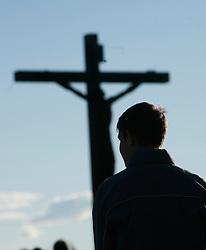 Man praying in front of  Jesus Christus.  (Photo by: Vid Ponikvar / Sportal Images).