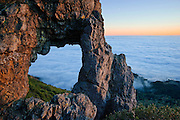 """""""Hole in the Wall Arch"""" high above the fog on 4,327' Mt. St. Helena in Robert Louis Stevenson State Park near Calistoga, California."""
