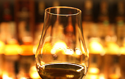 File photo dated 10/03/13 of a glass of whisky. Scotch whisky exports have risen by 4\% in a year to more than £4 billion, marking a return to growth for the sector.