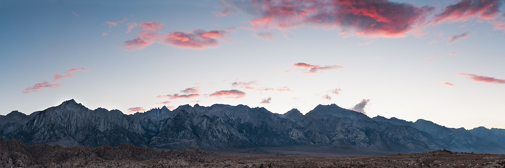 Sunset, The Sierras, California.   You hung over the range all afternoon, and occasionally tendrils of rain showed against the dark mountains, a mist that never made it to the ground down here.  An hour or so before sunset, I set off on a ride down the dirt roads in the Alabama Hills, a jumbled rock garden that lays beneath Mount Whitney and the Eastern Sierra.  The sun dropped uneventfully behind the cloak of your overcast, it's passing unnoticed until, almost suddenly, you broke apart into individual formations and lifted in a mass escape away from the rock.  I had hoped you would stay, and warm the cold granite under a sunset blanket.  I watched while you scattered, maybe in response to someone else's ode to a cloud.   After a time, your flight was highlighted when the sun, as it must, dropped below the earth's horizon. Pieces of you glowed in exodus, and I wondered, why did you go?