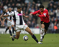 Photo: Lee Earle.<br /> West Bromwich Albion v Manchester United. The Barclays Premiership. 18/03/2006. Albion's Curtis Davies (L) is tracked by kieran Richardson.