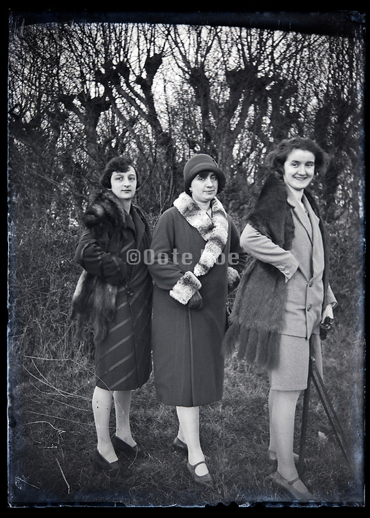 three fashionable adult women putting up a pose France circa 1920s