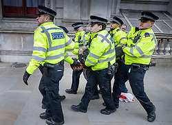 © Licensed to London News Pictures. 31/10/2019. London, UK. Six police officers arrest a man as Pro-Brexit protesters gather near Downing Street on what would have been the United Kingdom's last day as a member of the European Union. The date of Brexit had been moved to January 31, 2020 after MPs failed to pass Prime Minister Boris Johnson's withdrawal agreement. Photo credit: Peter Macdiarmid/LNP
