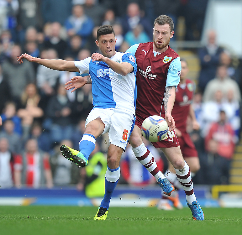 Blackburn Rovers' Jason Lowe and Burnley's Ashley Barnes battle for the ball <br /> <br /> Photo by Dave Howarth/CameraSport<br /> <br /> Football - The Football League Sky Bet Championship - Saturday 9th March 2014 - Blackburn Rovers v Burnley - Ewood Park - Blackburn<br /> <br /> © CameraSport - 43 Linden Ave. Countesthorpe. Leicester. England. LE8 5PG - Tel: +44 (0) 116 277 4147 - admin@camerasport.com - www.camerasport.com