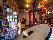 """09 FEBRUARY 2014 - HAT YAI, SONGKHLA, THAILAND: A woman prays in the Chao Mae Tubtim Shrine (Ruby Goddess Shrine) on 108 Hainanese Ancestors Memorial Day in Hat Yai, Songkhla, Thailand. Hainanese communities around the world celebrate """"108 Hainanese Ancestors Memorial Day."""" The day honors the time when 109 Hainanese villagers fleeing life in Hainan (an island off of the southwest coast of China, near Vietnam) washed up in what is now Vietnam and were killed by Vietnamese authorities because authorities thought they were pirates. The Vietnamese built a temple on the site and named it """"Zhao Yin Ying Lie."""" Many Vietnamese fisherman credit prayers at the temple to saving their lives during violent storms and now """"108 Hainanese Ancestors Memorial Day"""" is celebrated in Hainanese communities around the world. Hat Yai, the economic center of southern Thailand has a large Hainanese population.    PHOTO BY JACK KURTZ"""