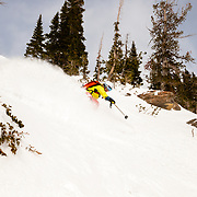 Steep & Deep participant skiing in the backcountry.