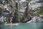 Kayaker looking up at Kittiwake Colony, Prince William Sound, Alaska