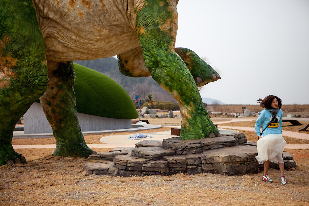 Visitors at the Haenam Uhangri Dinosaur Museum located on Jindo Island. Heanam Uhang-ri is a place first designated as a natural monument (No.394) among numerous natural properties in Korea. It is full of rare remains of dinosaurs, including world largest footprints of the Pterosur. Jindo Island is the 3rd biggest island in South Korea located in the South-West end of the country.