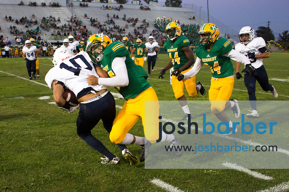 Northwood's Edward Yevdayev is brought down by Kennedy's Gabriel Solorzano during the second quarter of a non-league game A nonleague football game between Northwood High School of Irvine and John F. Kennedy High School at Glover Stadium on Thursday, September 1, 2016 in Anaheim, California. (Photo/Josh Barber)