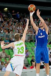 Leo Westermann of France shots while Miha Lapornik of Slovenia tries to block the shot during basketball match between National teams of Slovenia and France in Quarterfinal Match of U20 Men European Championship Slovenia 2012, on July 20, 2012 in SRC Stozice, Ljubljana, Slovenia. (Photo by Matic Klansek Velej / Sportida.com)