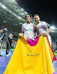 Real Madrid's Spanish defender Sergio Ramos celebrates holding a capote, a bullfighter's cape, after winning the UEFA Champions League final football match between Liverpool and Real Madrid at the Olympic Stadium in Kiev, Ukraine on May 26, 2018. - Real Madrid defeated Liverpool 3-1. Photo by Andriy Yurchak / Sportida
