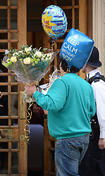 A man is seen entering with gifts on the birthday of the Duke of Edinburgh where he is currently a patient, The London Clinic in London, Monday, 10th June 2013<br /> Picture by Andrew Parsons / i-Images