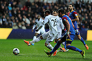 Swansea city's Jonathan De Guzman shoots and scores his sides 1st goal. Barclays Premier league, Swansea city v Crystal Palace match at the Liberty Stadium in Swansea, South Wales on Sunday 2nd March 2014.<br /> pic by Andrew Orchard, Andrew Orchard sports photography.