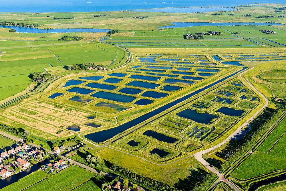 Nederland, Noord-Holland, Amsterdam (landelijk Noord), 13-06-2017; Waterland, overzicht met Volgermeerpolder. Na beeindiging van het vervenen werden de 'petgaten' volgestort met huisvuil en chemisch afval, onder andere met dioxine en benzeen afkomstig van Philips-Duphar. Inmiddels is de polder gesaneerd, de voormalige vuilstortplaats is afgedekt met folie en voorzien van en afdeklagen, bestaande uit zowel grond als ook water. <br /> The Volgermeerpolder in the rural area near Amsterdam once a landfill site for heavily polluted household and industrial waste, has been cleaned up using natural capping and turned into a nature area.<br /> luchtfoto (toeslag op standard tarieven);<br /> aerial photo (additional fee required);<br /> copyright foto/photo Siebe Swart