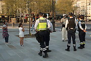 """April, 9th 2020 - Paris, Ile-de-France, France: Police control Parisians  while exercising at social distance protecting themselves from the spread of the Coronavirus, during the first month of near total lockdown imposed in France. A week after President of France, Emmanuel Macron, said the citizens must stay at home for at least 15 days, that has been extended. He said """"We are at war, a public health war, certainly but we are at war, against an invisible and elusive enemy"""". All journeys outside the home unless justified for essential professional or health reasons are outlawed. Anyone flouting the new regulations is fined. Nigel Dickinson"""