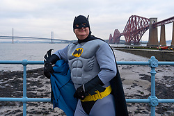 South Queensferry, Scotland, UK. 1st Jan 2020. People in fancy dress take the plunge into the Firth of Forth river during the annual New Year's Day Loony Dook at South Queensferry. Iain Masterton/Alamy Live News