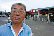 A portrait of a store owner by his reopened store after it was damaged in the tsunami in Shinchi, Fukushima, Japan, Sunday July 3rd 2011