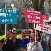 Modi supporters gather outside Westminster Abbey, holding placard to welcome Modi Commonweath Meeting on 18 April 2018 in Lonodn, UK