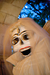 North America, Mexico, Oaxaca Province, Oaxaca, Pantheon San Miguel Cemetery, giant puppet greets visitors during annual Day of the Dead (Dias de los Muertos) celebration in November