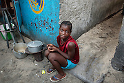 A girl sits outside her home in the West Point slum in Monrovia, Montserrado county, Liberia on Monday April 2, 2012.