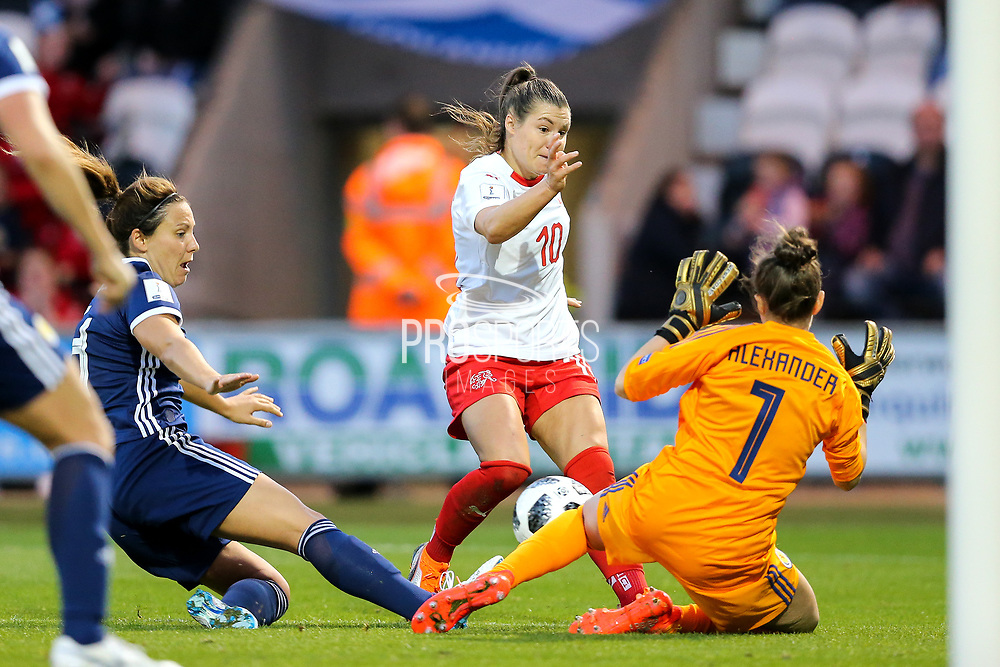 Ramona Bachmann (#10) of Switzerland shoots against as Lee Alexander (#1) of Scotland gets down to make the save during the 2019 FIFA Women's World Cup UEFA Qualifier match between Scotland Women and Switzerland at the Simple Digital Arena, St Mirren, Scotland on 30 August 2018.