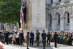 Whitehall, London, May 24th 2017.  Wreaths are laid at the Cenotaph on Whitehall in London as The Band of the Welsh Guards and the Colour Guard of the United Nations Veterans Association lead members of the diplomatic corps and wreath layers from The Royal United Services Institute as they observe The International day of United Nations Peacekeepers, amid tight security. PICTURED: Soldiers from different nations lay wreaths at the Cenotaph in Whitehall.