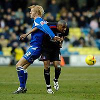 Photo: Daniel Hambury.<br />Millwall FC v Crystal Palace. Coca Cola Championship. 18/02/2006.<br />Millwall's Zak Whitbread (L) and Palace's Clinton Morrison battle.