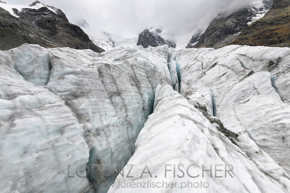 Rocks, ice walls and crevasses of the Morteratsch glacier, Pontresina, Grisons, Switzerland