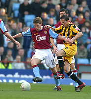 Photo: Dave Linney.<br />Aston Villa v Port Vale. The FA Cup. 28/01/2006Port Vales .Michael Husbands(R) fights for the ball with   Steven Davis