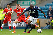 Captain Danny Shittu of Millwall breaks away from Joe Ralls of Cardiff City. Skybet football league championship match , Millwall v Cardiff city at the Den in Millwall, London on Saturday 25th October 2014.<br /> pic by John Patrick Fletcher, Andrew Orchard sports photography.