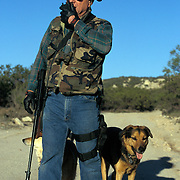Armed rancher patrols the U.S.-Mexico border in San Diego, California in hopes of stopping the undocumented migrants from crossing their property into the United States. Please contact Todd Bigelow directly with your licensing requests.