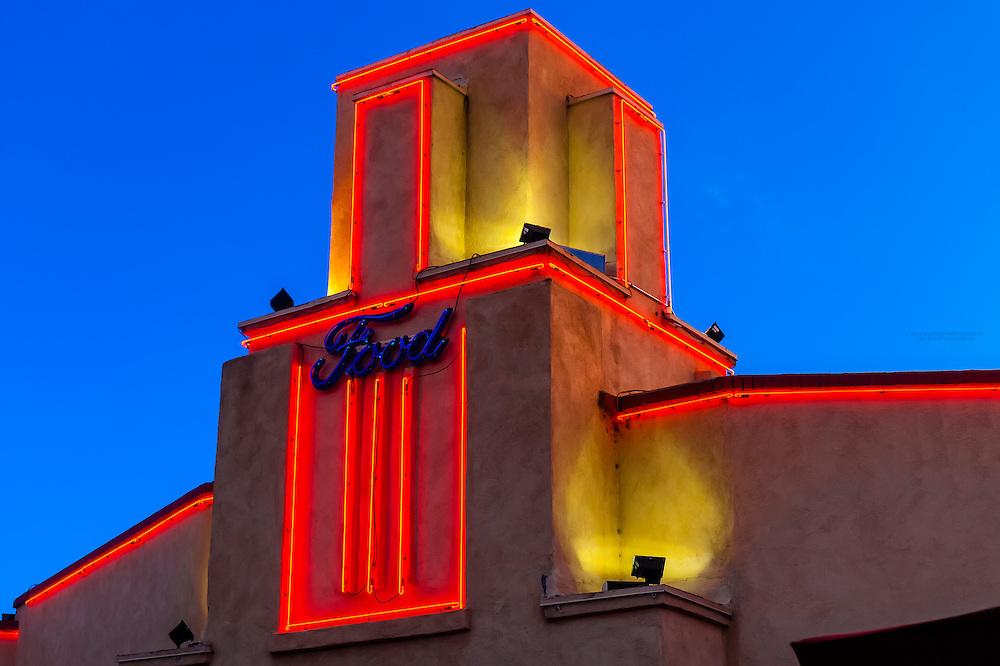 Neon trim along the building, Kelly's Brew Pub, a landmark building (the old Jones Motor Company, built in 1939), Nob Hill, Albuquerque, New Mexico USA.