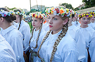 Lithuanian Song Celebration (Song and Dance Festival) 90th anniversary, Vilnius, Lithuania (5 July 2014). Pictured here, a folkdance ensemble waits to perform on Dance Day - a huge, elaborately choreographed traditional dance performance, held in the Zalgiris Stadium in Vilnius. The Song Celebration in Vilnius is Lithuania's greatest cultural event, occurring only once every four years, and along with similar festivals in Latvia and Estonia, is inscribed on the UNESCO list of Intangible Cultural Heritage. © Rudolf Abraham.