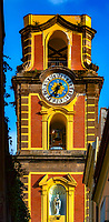 **Campanile della Cattedrale dei Santi Filippo e Giacomo – Sorrento<br /> <br /> The main church in Sorrento is the Duomo, also known as the Cathedral of San Filippo and San Giacomo, which is concealed right in the heart of the town. Sorrento is not known as a pilgrimage site, but a beautiful seaside resort village. The Duomo dates as far back as the 11th century but was completely rebuilt in the 15th century in Romanesque style. The façade is very plain for a Cathedral of such interior grandeur, which has three naves separated by pillars and a very ornate ceiling. Next to the cathedral is a bell tower resting on an arch with four columns, which dates back to medieval times. Inconspicuously, I entered the cathedral and saw only a dozen elderly women sitting in the front pews reciting aloud a novena. Not wanting to disturb them, I ventured around quietly and was taken aback by the reverent beauty and peaceful aura of the magnificent Duomo. Hanging above the Altar was a lifelike Crucifix. It was not as large as it appears in the photos; however, the closer I ventured…the more mesmerized I became. Slowly and quietly moving about, from different angles I was able to capture dramatic images of window light illuminating Christ in a mystical way. This image with the sunlight shining through the window is one of my most meaningful and favorite images from my Italian journey. I believe that if you gaze for a minute or two, you will also be transported on a remarkable journey.