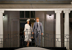 The Duke and Duchess of Sussex wave from the balcony of the Grand Pacific Hotel, in Suva, Fiji, on day one of the royal couple's visit to Fiji.