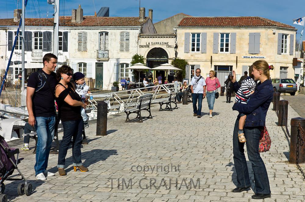 Tourists taking photographs at Quai Job Foran, St Martin de Re on Ile de Re in France