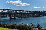 Cyclists pass along the walkway near the Iron Cove Bridge, Sydney, Australia,