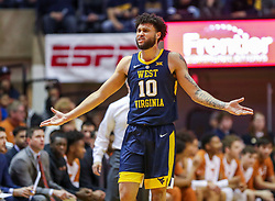 Feb 9, 2019; Morgantown, WV, USA; West Virginia Mountaineers guard Jermaine Haley (10) argues a call during the first half against the Texas Longhorns at WVU Coliseum. Mandatory Credit: Ben Queen-USA TODAY Sports