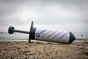 A giant COVID-19 vaccine syringe used for a campaign by The People's Vaccine Alliance on the 11th of June 2021 near Falmouth, Cornwall, United Kingdom.