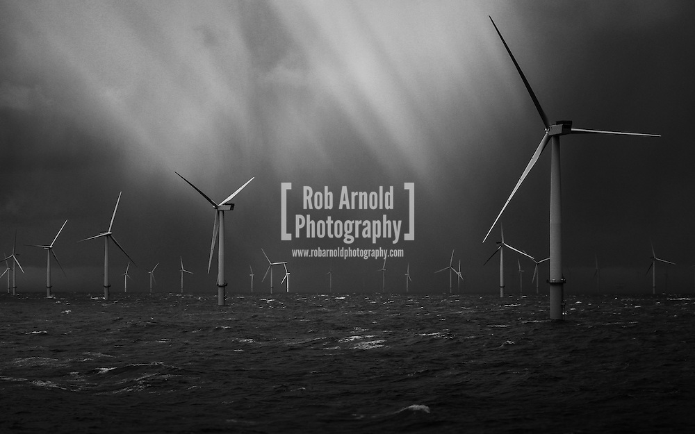 22/03/2014. North Wales, UK. Showers passing over the Gwynt y Môr Offshore Wind Farm off the coast of North Wales. Photo by Rob Arnold